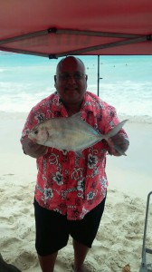 Hawaii Phil with a barred trevally caught on a sand crab